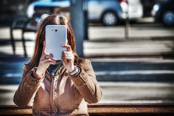 close up of a woman taking a selfie in hdr