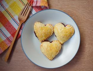 Fresh Homemade Raspberries and lemon crust hearts on a plate