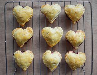 Homemade Raspberries, lemon crust hearts on a cooling rack
