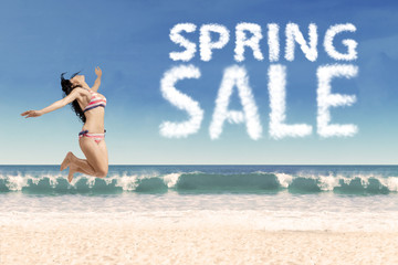 Happy girl at beach with spring sale