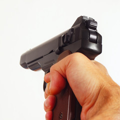 Hand with a army semi-automatic pistol close up
