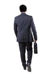 Male worker walking forward in the studio