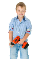Caucasian handsome little boy is holding a screwdriver.