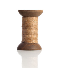 Old wooden bobbins of thread, vintage, isolated on white