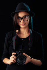 Cute hipster girl with digital camera