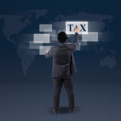 Manager with tax word on futuristic screen