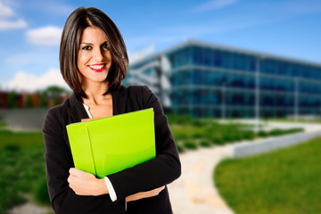 smiling business woman exterior office building