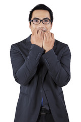 Stressful entrepreneur biting nail