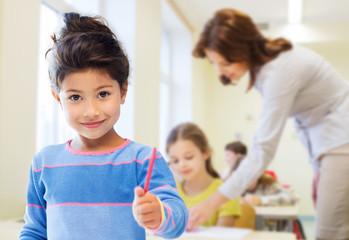 happy little school girl over classroom background