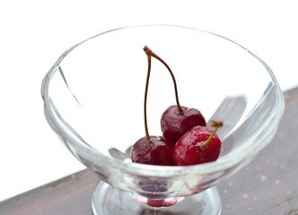 Ice cherry lies in a glass vase