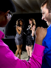 two pickup artists harrassing women at a nightclub
