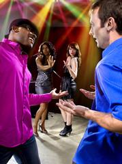 two pickup artists harrassing women at a nightclub