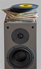 Vinyl records 45 rpm laid on a loudspeaker