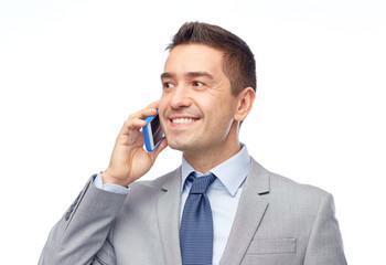 happy businessman calling on smartphone
