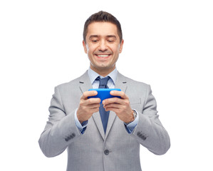 happy businessman texting on smartphone