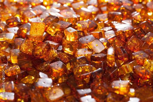yellow amber stones rectangular closeup lie on a flat surface - 78121312