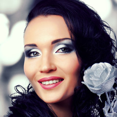 Beautiful woman with bright fashion silver make-up
