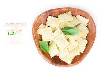 Homemade pasta ravioli with fresh basil, isolated over white bac