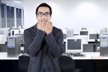 Worried male working in office