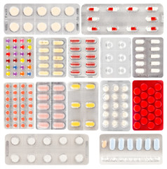 Set of pills in a plastic blister package, on white background