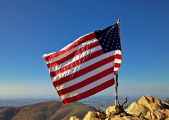 Tattered American Flag Blowing in the Wind Mountain Landscape