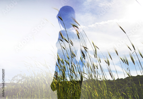 Double exposure of beautiful model and wheat