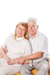 Affectionate elderly couple with beautiful beaming friendly
