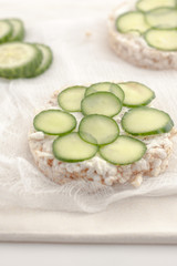 rice cakes with sliced cucumbers