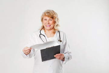 Smiling medical senior doctor with stethoscope.