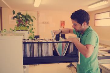 Clerk looking files at office