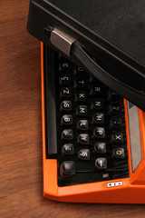 The Orange Vintage Typewriter on the Wood
