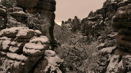 rock snowy alley