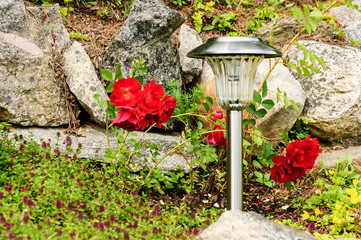 rock garden with solar lamp close view