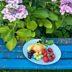 Healthy Sweet Fruits on Plate on Wooden Chair.