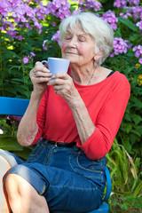 Senior Woman Enjoying the Aroma of her Coffee.