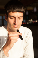 young man smoking e cigarette