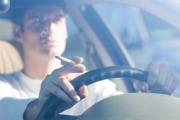 driving while holding a cigarette in hand