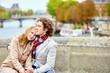 Couple in Paris, on the Seine embankment