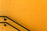 Orange Brick wall with handrail