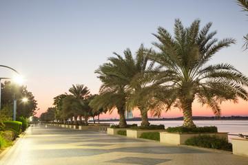 Promenade in Abu Dhabi illuminated at dusk, UAE