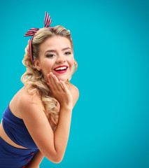 Beautiful girl with pretty smile in pinup style