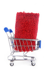 shopping trolley with carpet isoalted on white