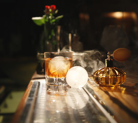 cocktail with a ball of ice