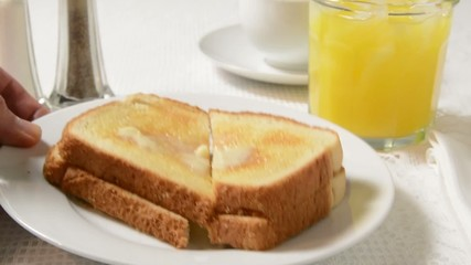 Serving orange juice and buttered toast