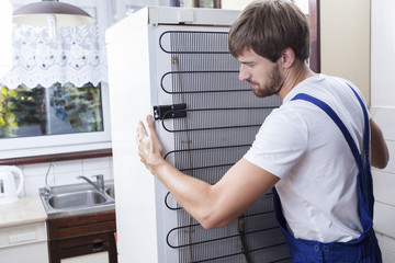 Handyman trying to move a fridge