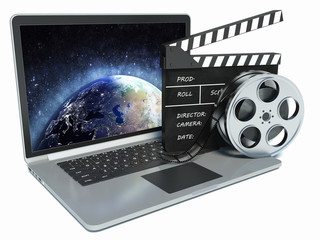 3d illustration of laptop and cinema clap and film reel. mountin
