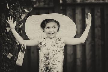 Girl Wearing Oversized Sun Hat - Vintage