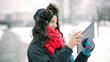Woman doing selfie in the park at winter time