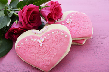 Heart shape cookies decorated as pink ladies dresses