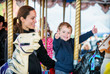 Boy with Two Thumbs Up with Mother on Carousel - 78136990